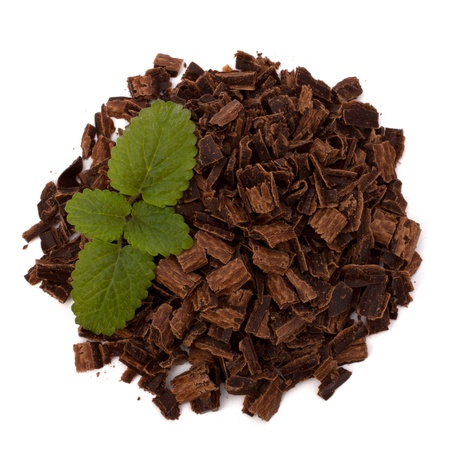 Crushed chocolate shavings pile and mint leaf isolated on white background Stock Photo - 9477395