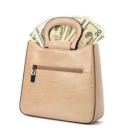 Glamour handbag full with money isolated on white background Stock Photo - 9477155