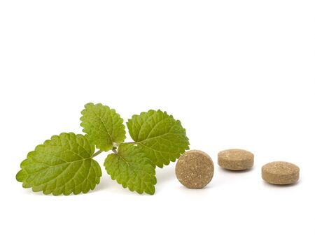 Herbal pills isolated on white background. Alternative medicine concept. photo