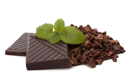 Chocolate bars and mint leaf isolated on white background photo