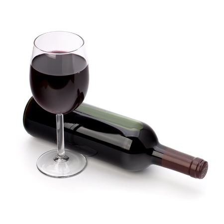 drinking glass: Full red wine glass goblet and bottle isolated on white background