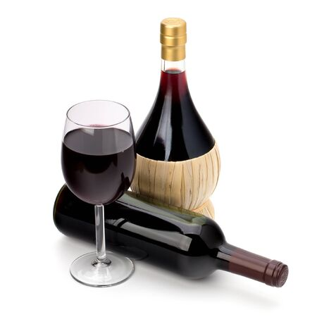 Full red wine glass goblet and bottle isolated on white background photo