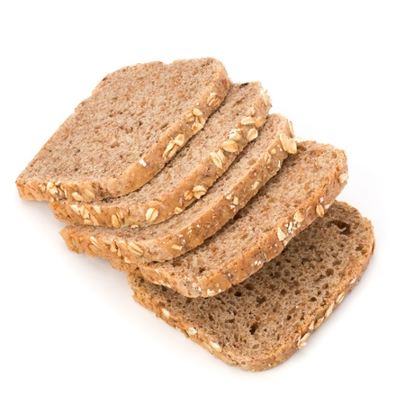 Healthy bran bread slices with rolled oats isolated on white background photo