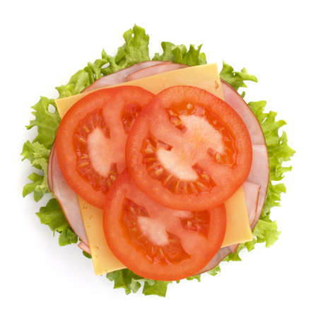 Healthy open sandwich with lettuce, tomato, smoked ham and cheese isolated on white background photo