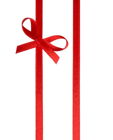 Festive gift ribbon and bow isolated on white photo