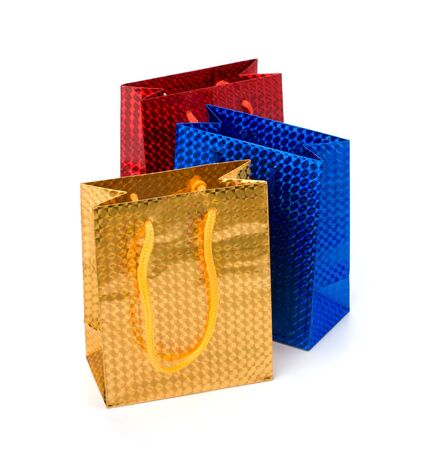 Glossy festive gift bags isolated on white background photo