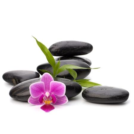 black pebbles: Zen pebbles balance. Spa and healthcare concept.