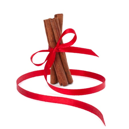 christmas scent: Festive wrapped cinnamon sticks isolated on white background Stock Photo