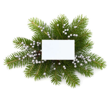 Christmas decoration with greeting card isolated on white background photo