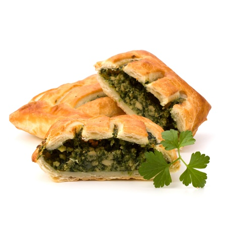 pasty: Puff pastry isolated on white background. Healthy pasty with spinach.