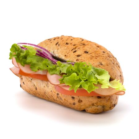 Big appetizing  fast food baguette sandwich with lettuce, tomato, smoked ham and cheese isolated on white background. Junk food subway. photo