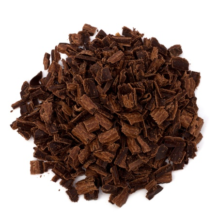 Crushed chocolate shavings pile isolated on white background Stock Photo - 10161445