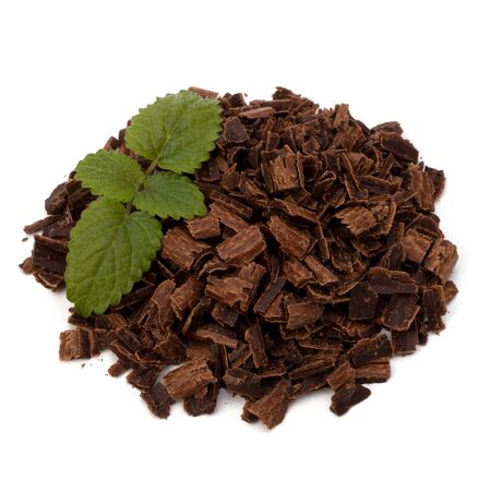 Crushed chocolate shavings pile and mint leaf isolated on white background Stock Photo - 10161502