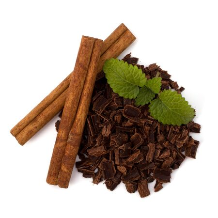 Crushed chocolate shavings pile and cinnamon sticks isolated on white background Stock Photo - 10161365