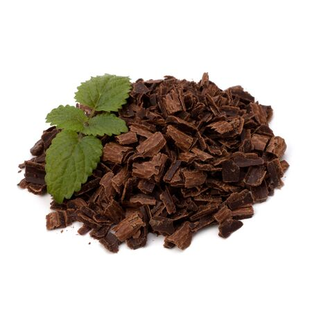 Crushed chocolate shavings pile and mint leaf isolated on white background Stock Photo - 10405764
