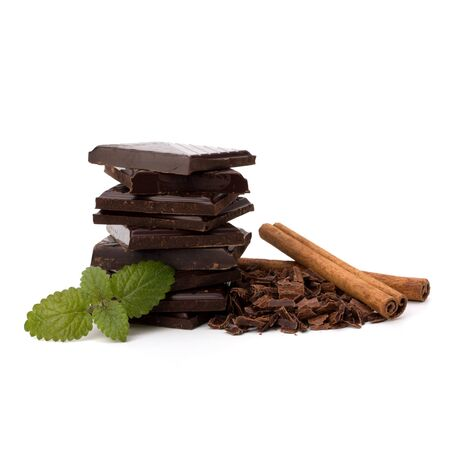 Chocolate bars stack and cinnamon sticks isolated on white background photo