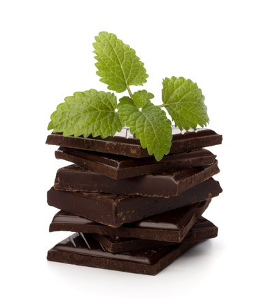 Chocolate bars stack and mint leaf isolated on white background photo