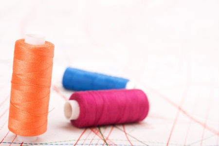 Spool of thread. Sew accessories on blurred background photo