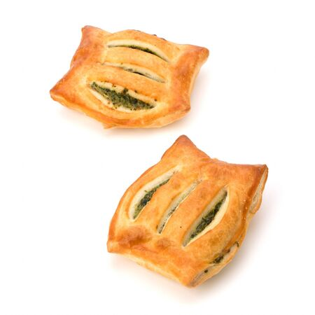 spinage: Puff pastry isolated on white background. Healthy pasty with spinach.