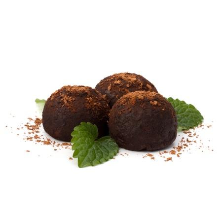 Chocolate truffle candy isolated on white background photo