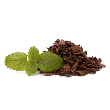 Crushed chocolate shavings pile and mint leaf isolated on white background Stock Photo - 10667230