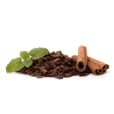 Crushed chocolate shavings pile and cinnamon sticks isolated on white background Stock Photo - 10667196