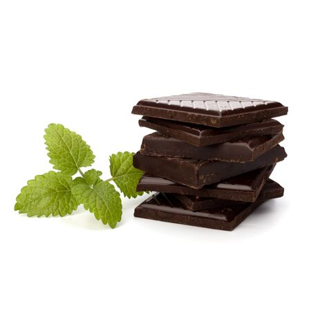 Chocolate bars stack and mint leaf isolated on white background Stock Photo