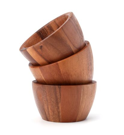 Handmade wooden bowl isolated on white background photo