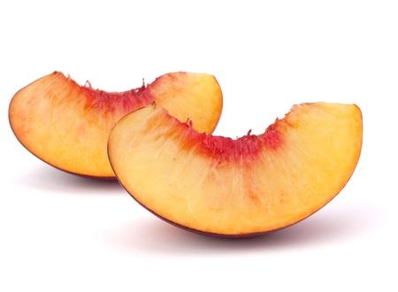 Nectarine fruit segments isolated on white background Stock Photo - 11062042