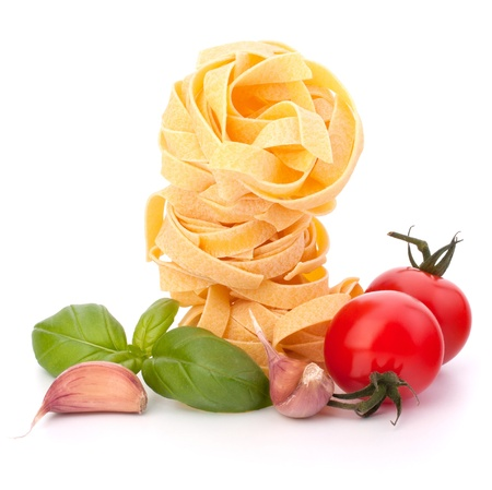 Italian pasta fettuccine nest  and cherry tomato isolated on white background Stock Photo - 11447165
