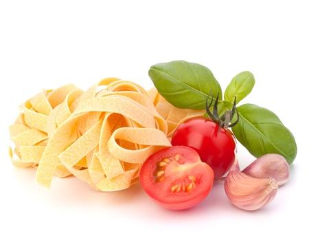 fettuccine: Italian pasta fettuccine nest  and cherry tomato isolated on white background Stock Photo