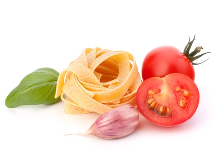 maccheroni: Italian pasta fettuccine nest  and cherry tomato isolated on white background Stock Photo