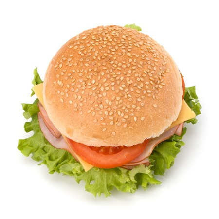 sub sandwich: Big appetizing fast food sandwich with lettuce, tomato, smoked ham and cheese isolated on white background. Junk food hamburger. Stock Photo