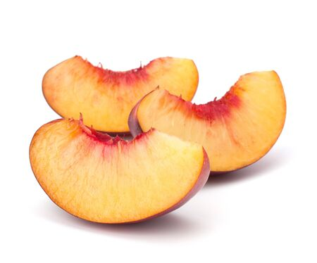 Nectarine fruit segments isolated on white background photo