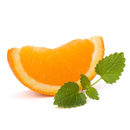 Orange fruit segment and citron mint leaf isolated on white background photo