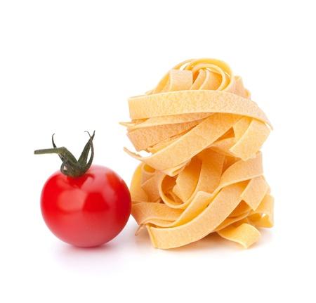 Italian pasta fettuccine nest  and cherry tomato isolated on white background Stock Photo - 13191206