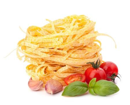 Italian pasta tagliatelle nest and cherry tomato isolated on white background photo