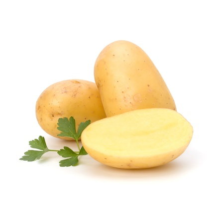 New potato and green parsley isolated on white background close up photo