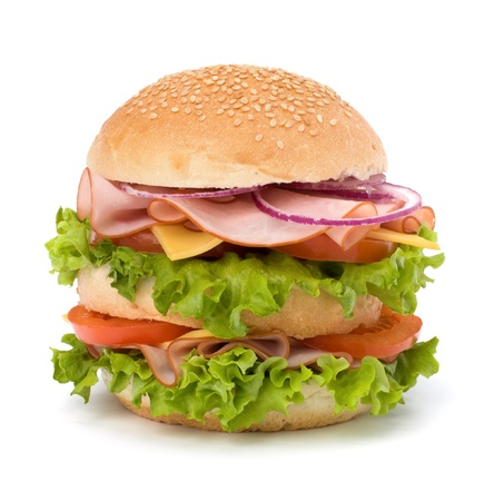 Big appetizing fast food sandwich with lettuce, tomato, smoked ham and cheese isolated on white background. Junk food hamburger. photo