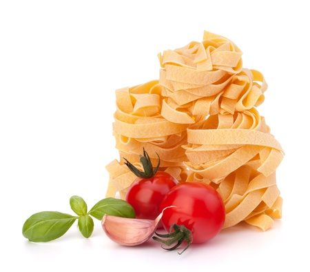Italian pasta fettuccine nest  and cherry tomato isolated on white background photo