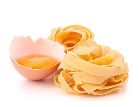 Italian egg pasta fettuccine nest isolated on white background Stock Photo - 13192100
