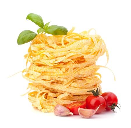 Italian pasta tagliatelle nest and cherry tomato isolated on white background Stock Photo - 13192279