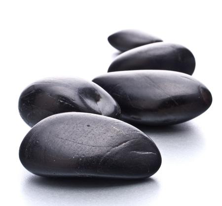 black pebbles: Zen pebbles. Stone spa and healthcare concept.