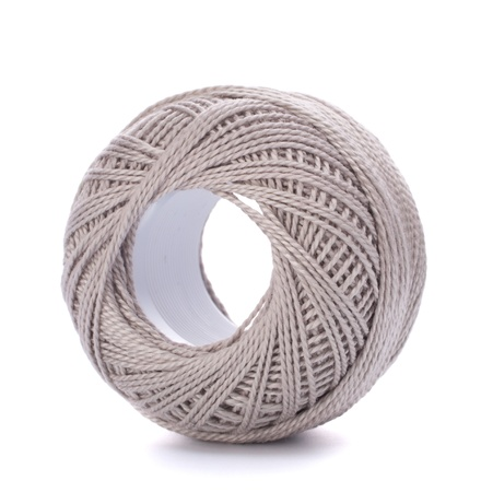 spool of grey thread isolated on white background photo