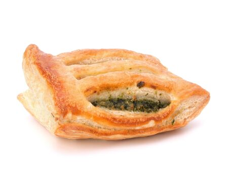 pasty: Puff pastry bun isolated on white background. Healthy patty with spinach.