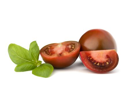 Tomato kumato and basil leaf isolated on white background photo
