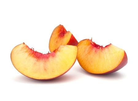 Nectarine fruit segments isolated on white background photo