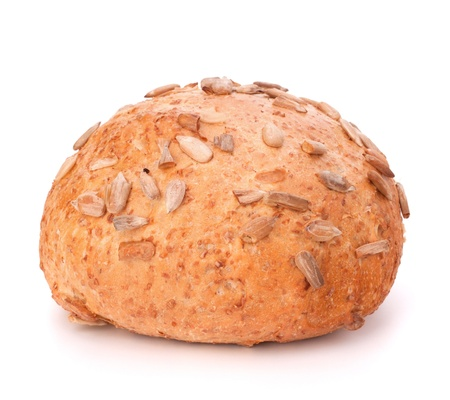 Round sandwich bun with sunflower seeds isolated on white background photo