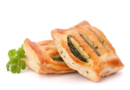 Puff pastry bun isolated on white background. Healthy patty with spinach. Stock Photo - 13297577
