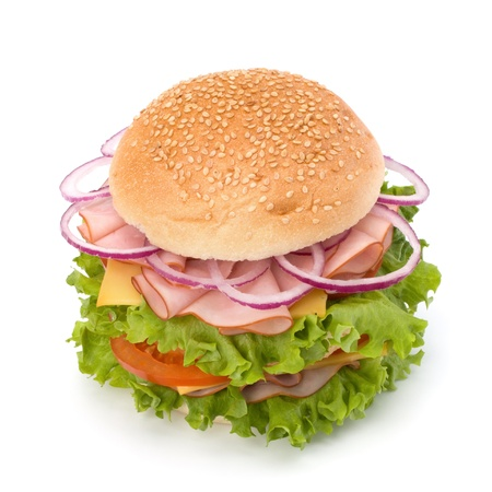 Big appetizing fast food sandwich with lettuce, tomato, smoked ham and cheese isolated on white background. Junk food hamburger. Stock Photo - 13297582